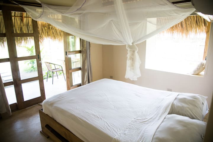Queen bed and mosquito net