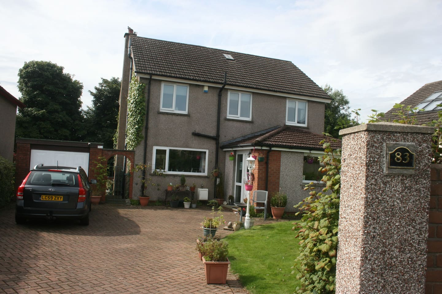 Rear of house which includes access drive & main door.