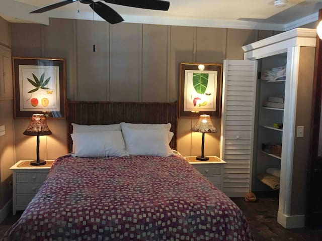 Master bedroom with ample closets, local artists work throughout