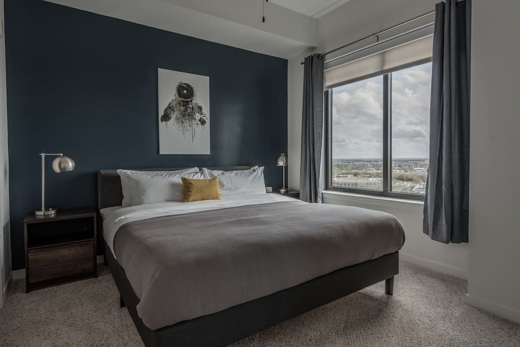 Spacious king bed with blackout curtains