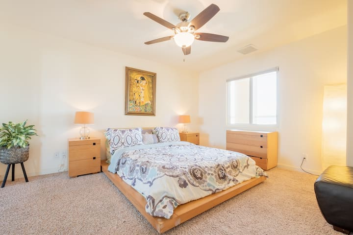 Spacious third bedroom with queen size bed.