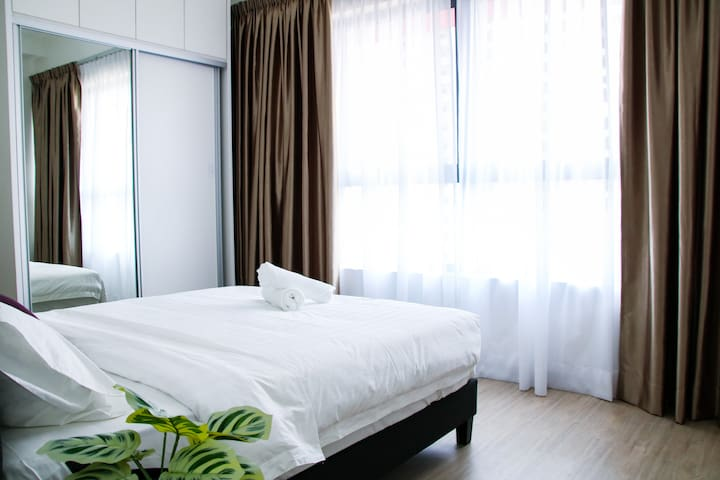 Natural sunlight can easily breeze through the curtain in the bedroom. Waking up has never been easier.
