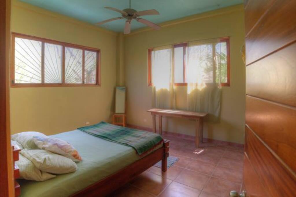Bedroom with Queen bed, ceiling fan & AC