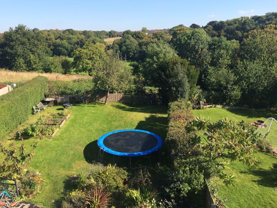 View from the top bedroom, fire pit/ barbecue in left corner of the garden