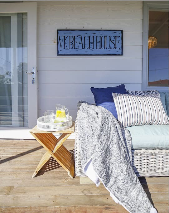 Outdoor upper level deck.  Comfy outdoor lounge & lots of deck chairs.