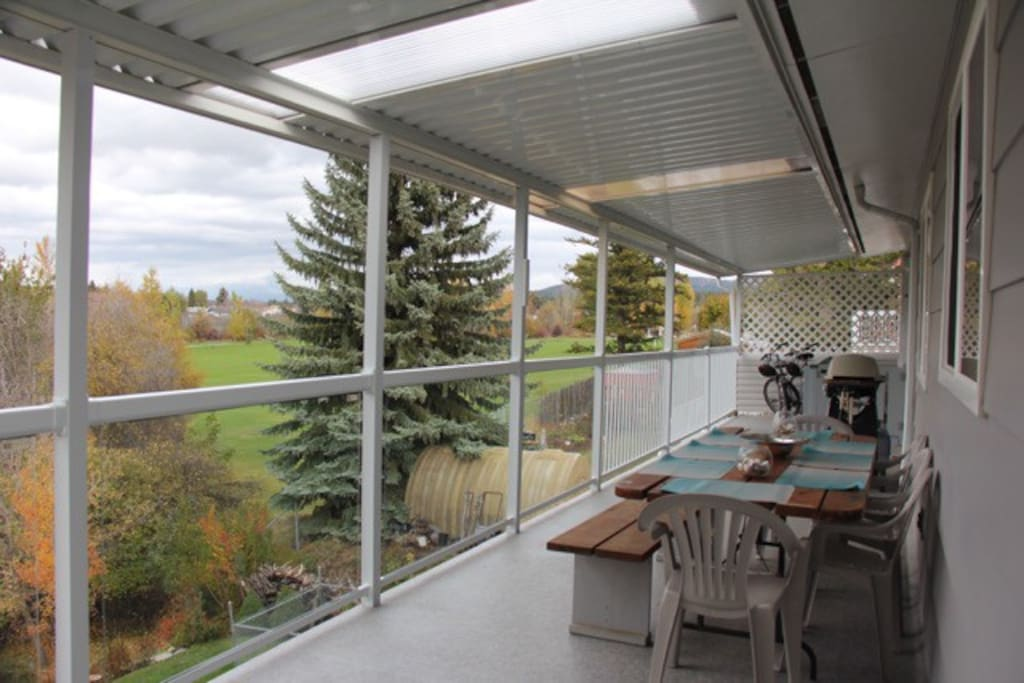 The huge upper and lower decks back directly onto a running creek and feature amazing views of the Rocky and Purcell Mountains.