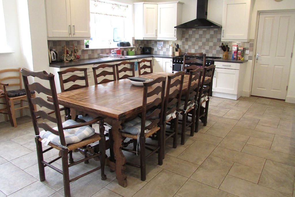 The Kitchen is a superb large room with range cooker, large fridge freezer, a second fridge, washing machine, dryer, dishwasher, microwave, fitted units and lots of utensils. Furnished with an 8' extendable table seating at least twelve, Welsh dresser and wooden settle.