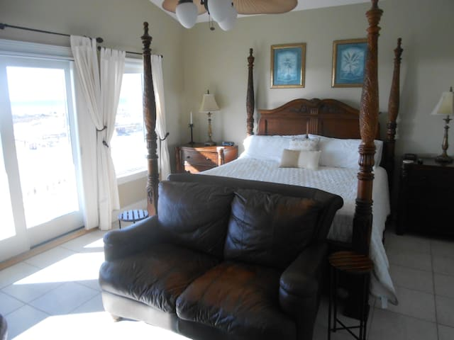 Master bedroom - king bed with full beach view to watch morning sunrise.