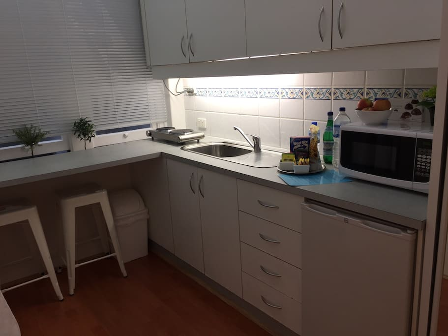 Clean eat in kitchen with tea and coffee making facilities.