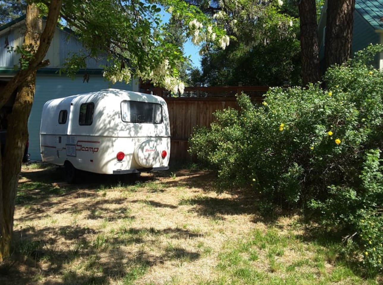 """The Scamp parked around back of my """"Little Goat House,"""" in the driveway and outside the 6ft backyard fence."""