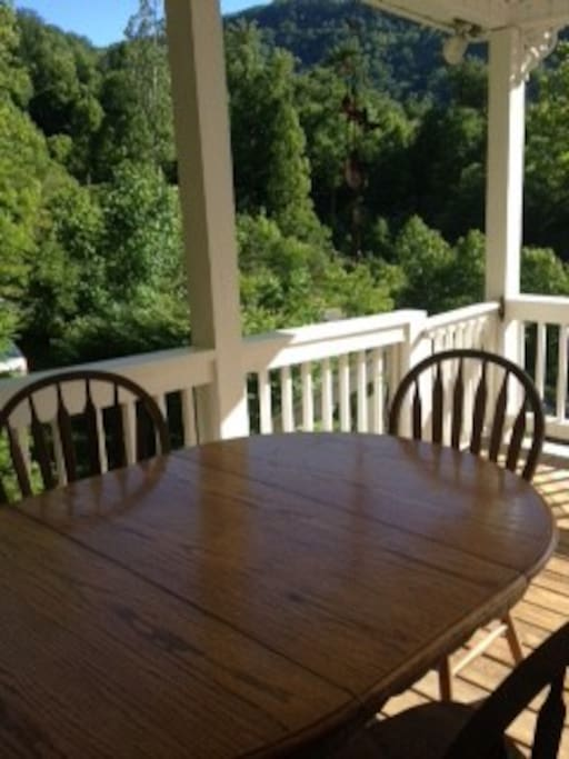 Outdoor seating for meals on the porch