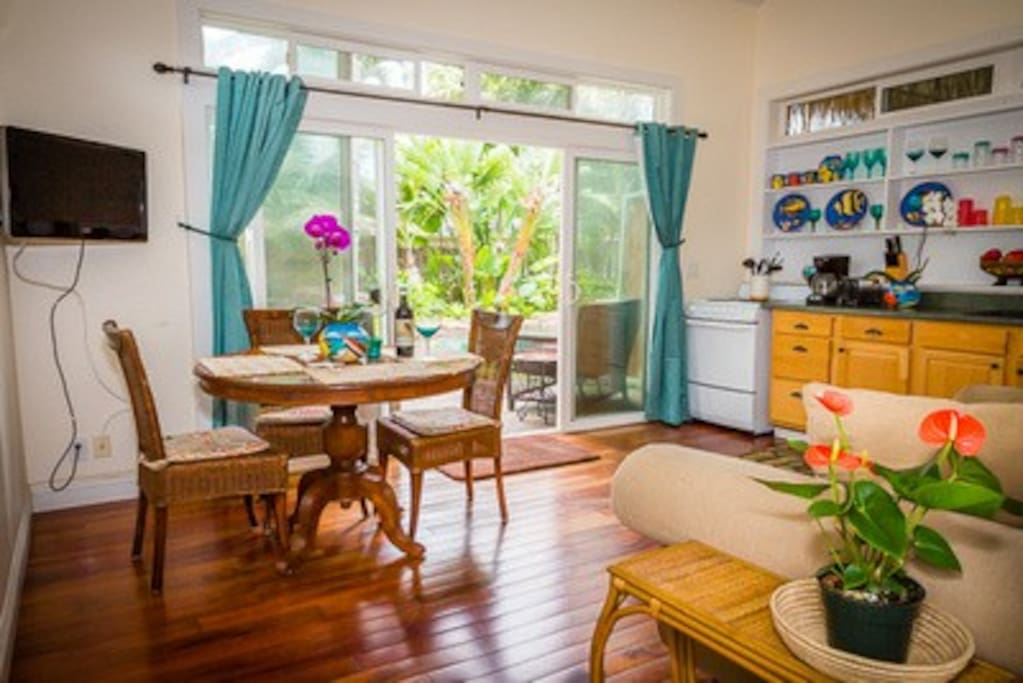 Your own private kitchen and dining area looks out over the pool.