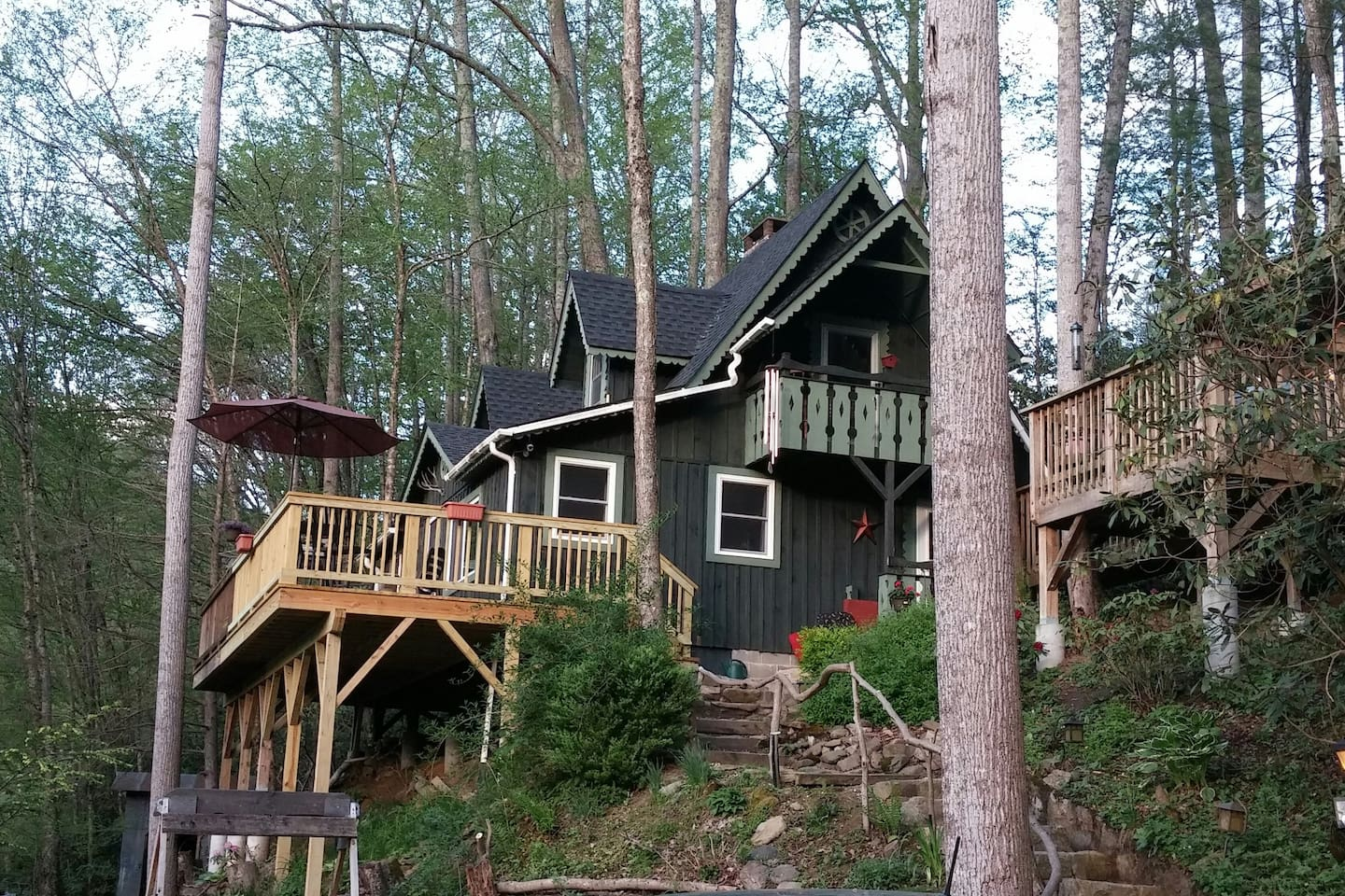 Cozy Creekside Cabin  - Outdoor Covered Hot Tub right side of photo.  - Laurel Fork Creek not pictured to the left of Large Balcony.