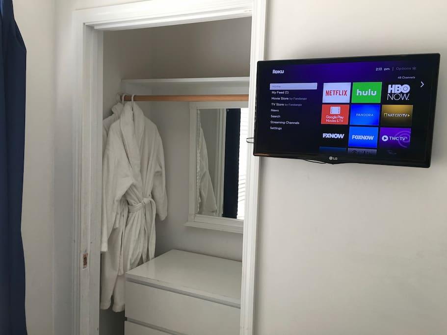 Closet w/dresser and 2 fresh white robes