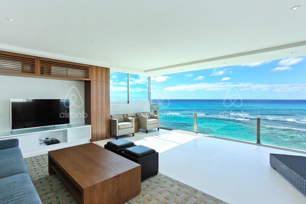 Living room opens to  full ocean view