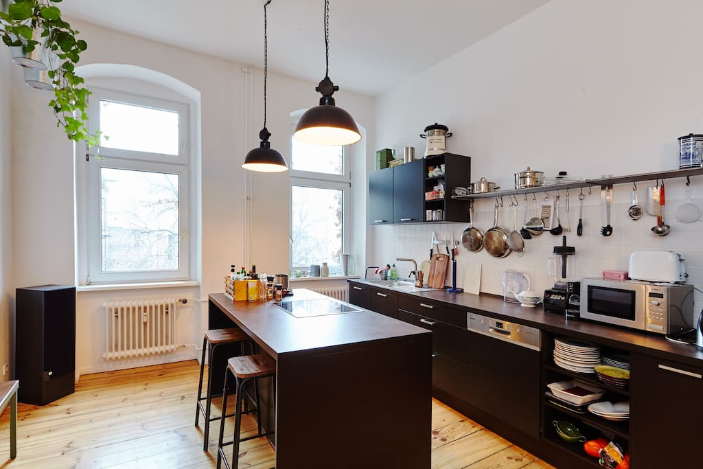 The open kitchen invites to cook together and enjoy good company. It is well equipped with various high-end kitchen appliances and utensils.