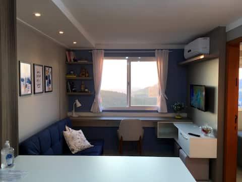 Apartamento aconchegante com vista para o vale