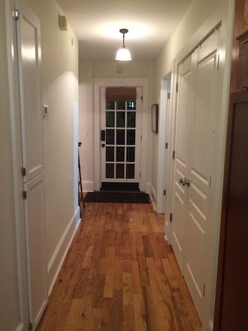 Central hallway looking toward rear exterior door.  Your room and bath are conveniently located next to the door.