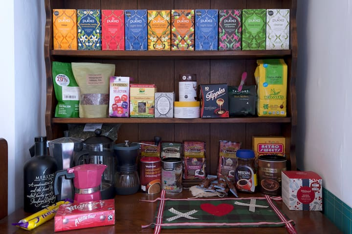 You are welcome to help yourself to any teas, coffees and biscuits on the Welsh dresser in the dining room.