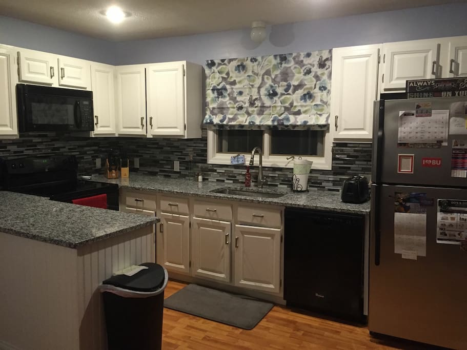 Newly renovated kitchen and new appliances with granite countertop.