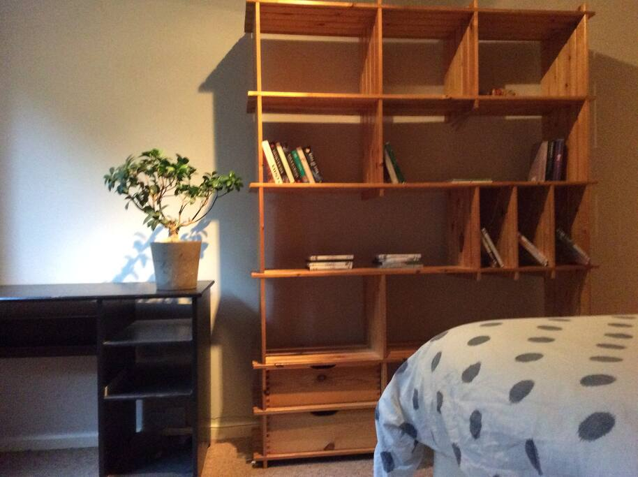 Bedroom 1- king size bed, wardrobes,shelves,view of the garden