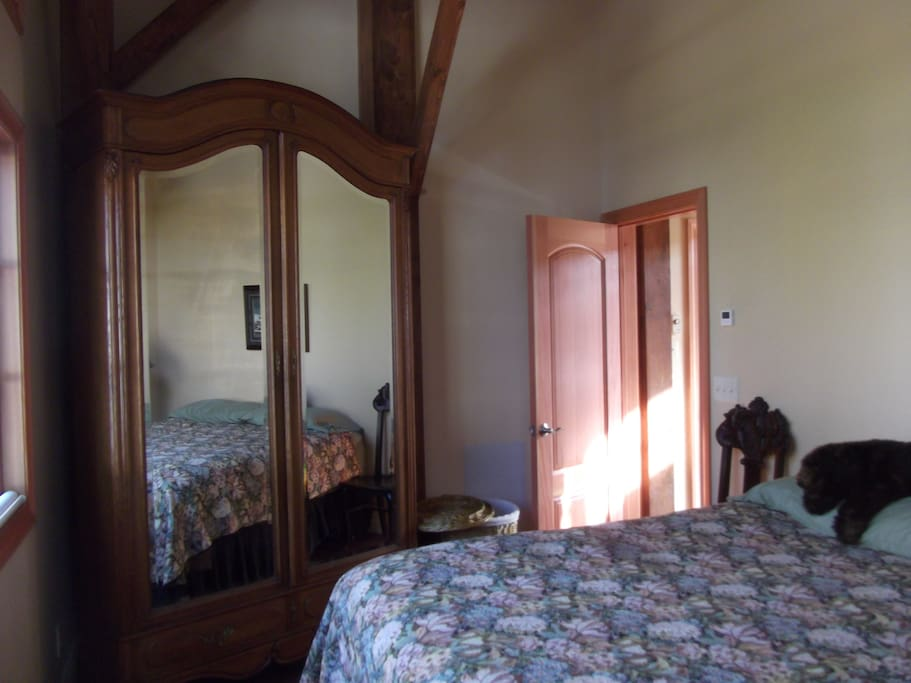 Bedroom with antique armoire and king size bed