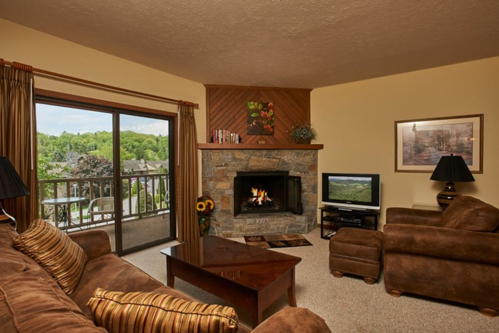 Open living with stone, wood burning fire place
