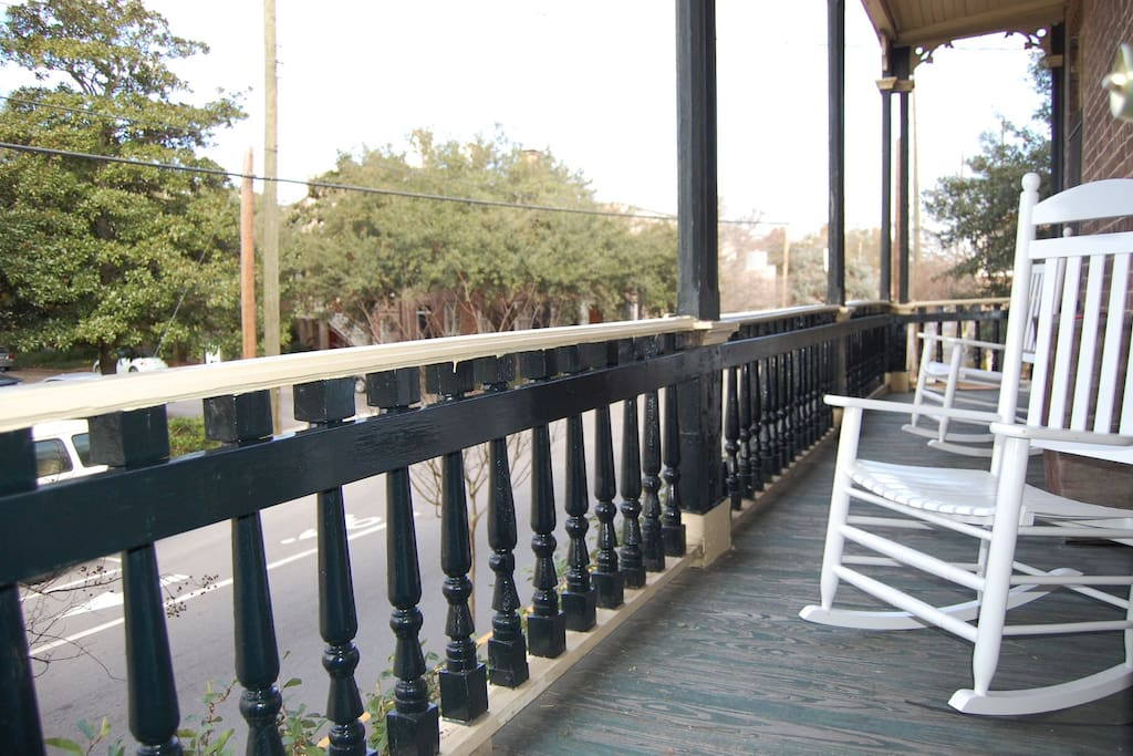 Side porch has 2 rocking chairs