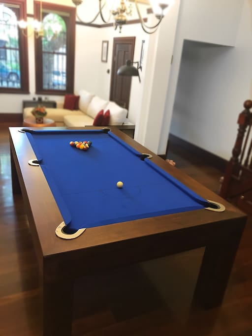 The first lounge on the main floor with our exceptional hand made to order wooden pool table.