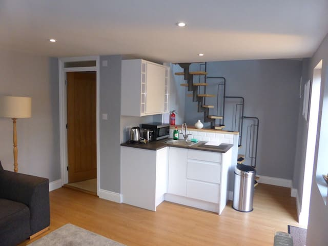 Kitchen area with microwave, kettle and toaster