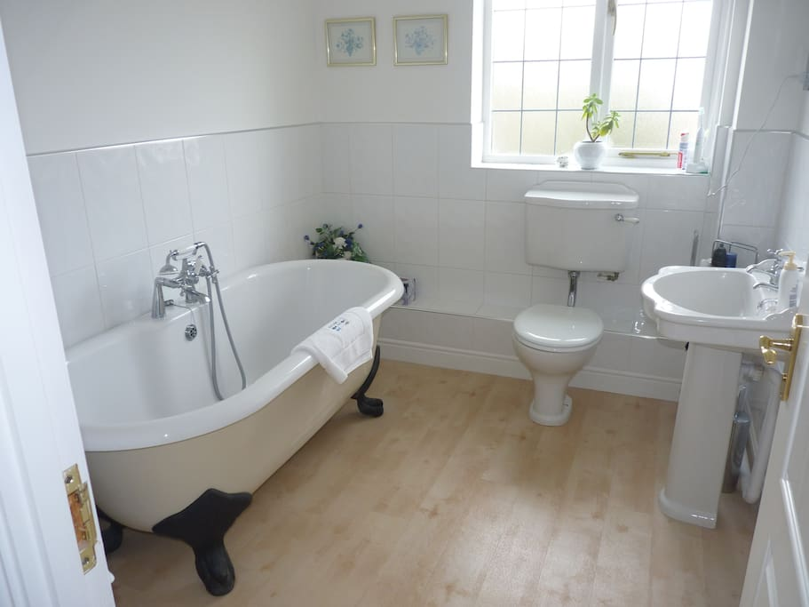 Adjoining private bathroom. Large deep bath for soaking!