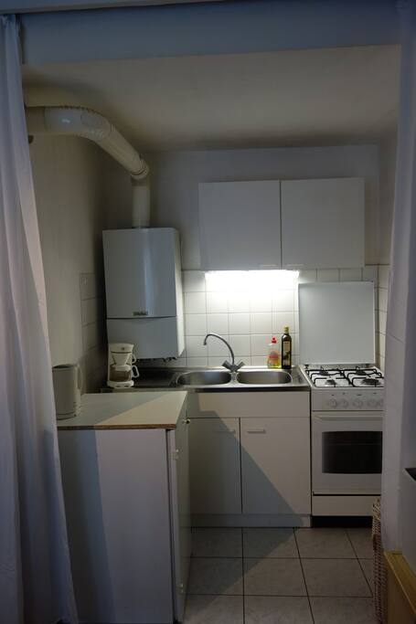 Small Kitchen with Fridge, Cooker & Dishes