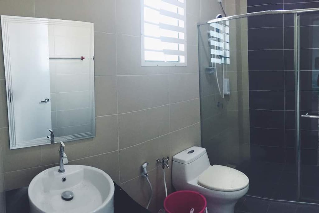 Pristine shared bathroom complete with hot shower pump.