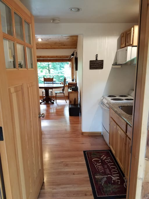 Entry into the Kitchen. Full size refrigerator, oven and Keurig coffee maker.