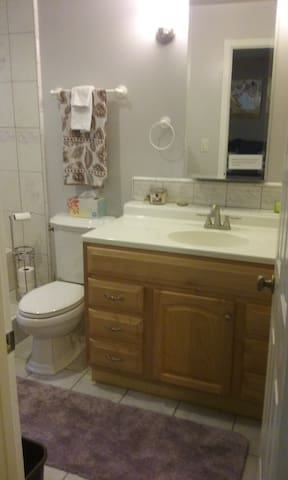 Bathroom with double shower, jetted tub.