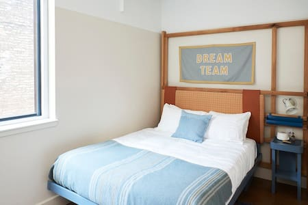 Our Queen Room is outfitted with a comfortable Casper Mattress and plush pillows.