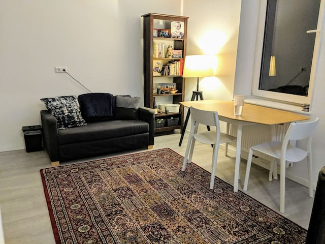 Room with private living area and kitchenette