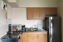 fully functional kitchen with stove, fridge, microwave oven, toaster, rice cooker, water kettle etc!