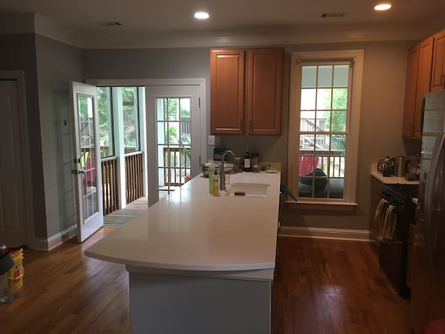 Newly renovated kitchen leading out to to the screened porch!