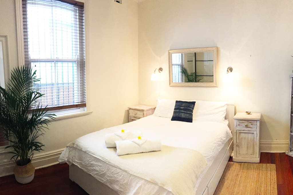 Your beautiful bright large double bedroom with comfy queen size bed, large built ins, bedside tables, shelves and a small desk.
