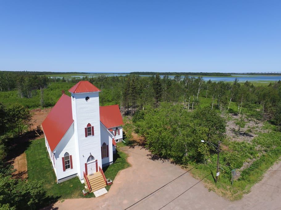 The Church House is very Close to the ocean and the Conferderation Bridge to Prince Edward Island