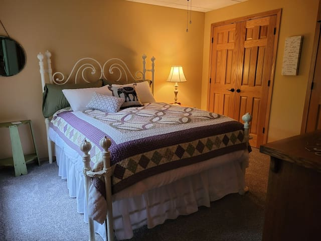 Queen sized bed which guests say is very comfortable. Large bedroom with ample closet storage and dresser space