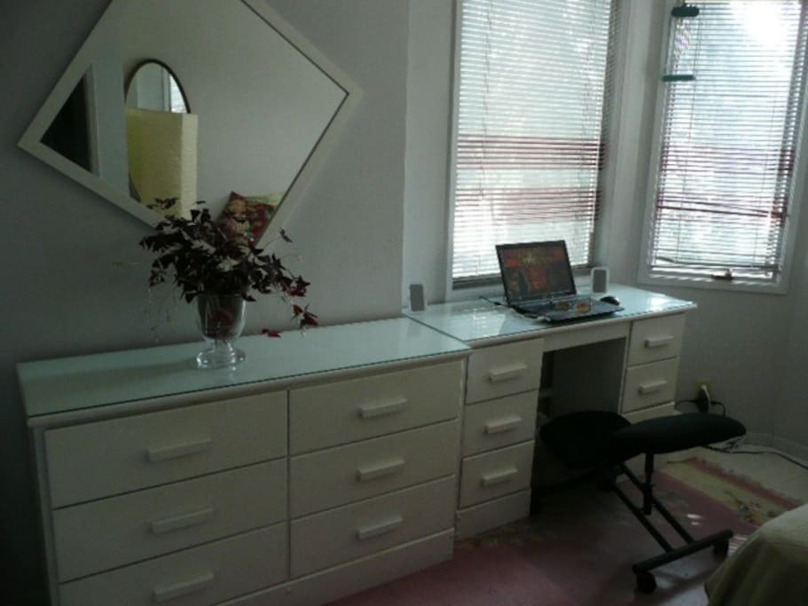 Single room with private desk area.