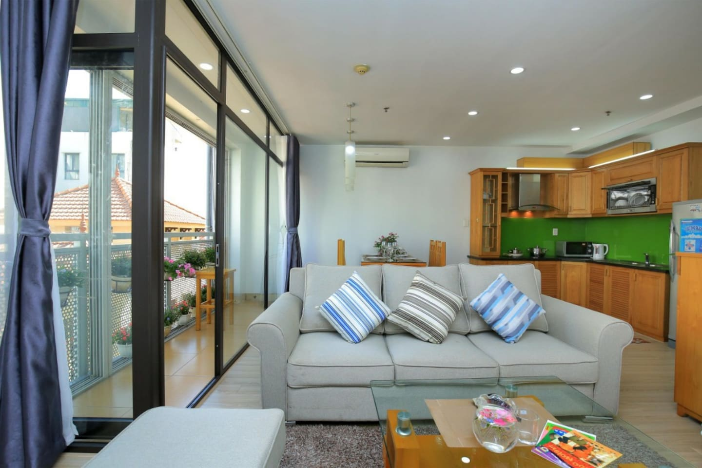 61. comfortable sofa in living room. And modern cooking facilities plus overview bacony