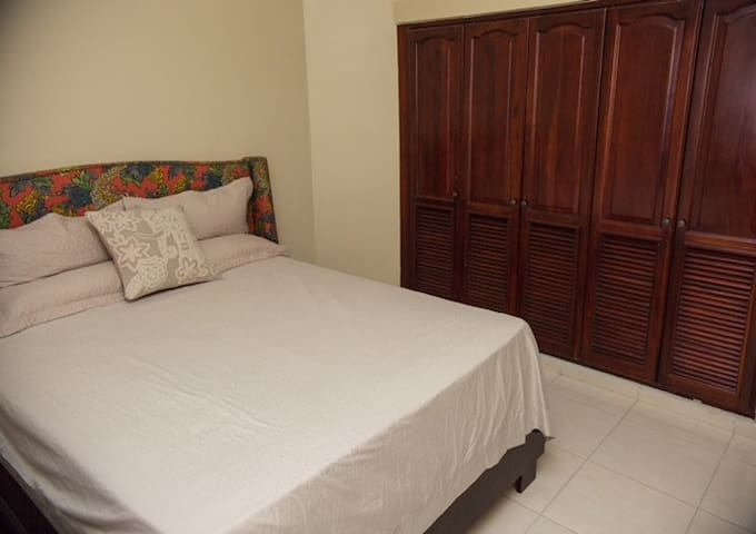 Second bedroom with a queen bed, tv, cable, wifi and air conditioner.