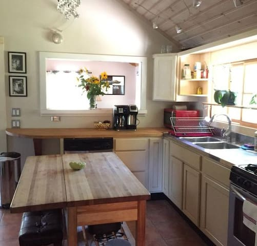 Kitchen with coffee maker and microwave