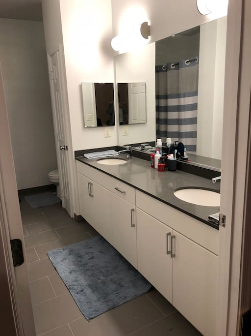 Large Private Bathroom with His & Her Sink