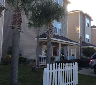 Comfortable living room front and back porche to relax with a cool sunset internt and wifi, Direct-tv HBO and MAX landline if need and washer and dryer in home. Kitchen has all utensils extra freezer and Grill on patio Transportation Available around the area or Airport service