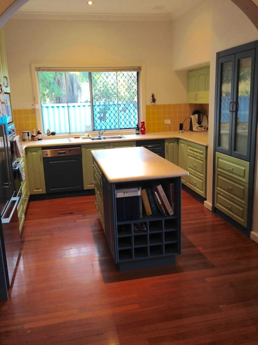 Large kitchen with all cooking utensils and crockery, toaster, kettle and dishwasher.