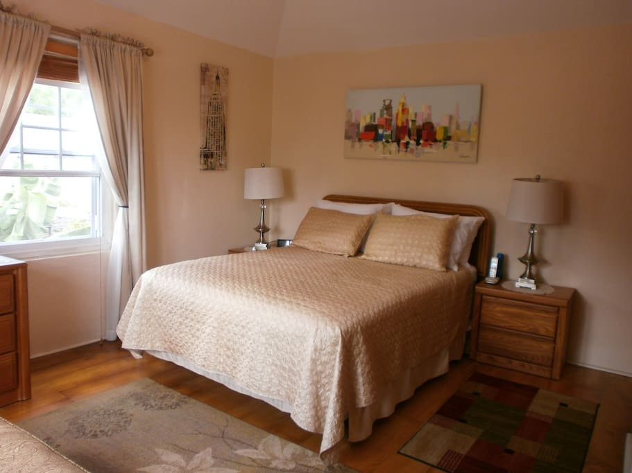 The bedroom is light and airy!